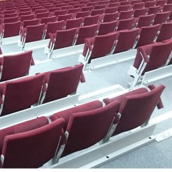 Telescopic tribunes with upholstered seats