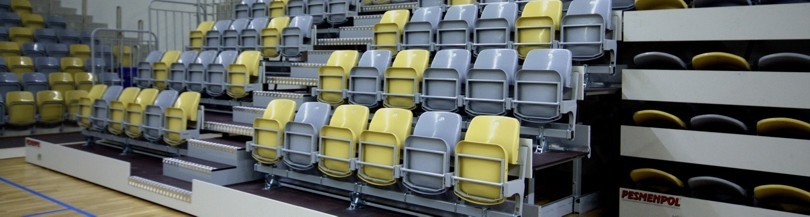 Telescopic tribunes with tilting under gravity seats