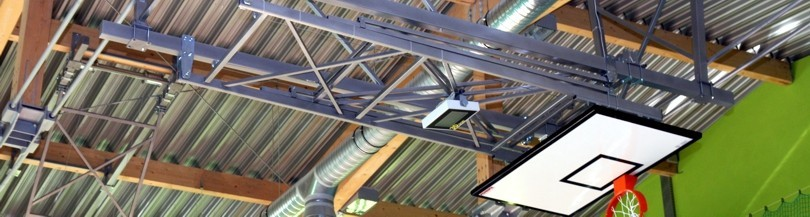 Ceiling mounted basketball structures with electric drive